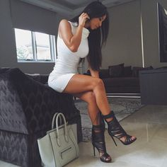 White turtle neck dress, killer heels, name brand purse