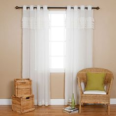 These pleated faux-linen curtains are a great way to upgrade your home. This two-panel set is 100 percent polyester and machine washable. The opaque drapes allow a dim, ambient light into a room when drawn shut. These curtains are 84 inches long.