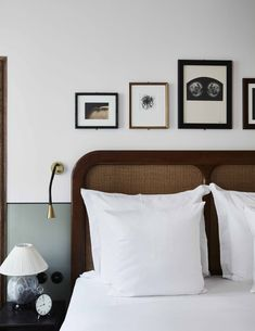 A bedroom with a tactile wicker headboard, a lamp from Marshall Phillips and art curated by Dais Contemporary