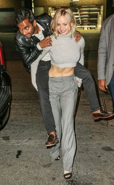 Jennifer Lawrence & Aziz Ansari from The Big Picture: Today's Hot Pics  The actress gives the actora piggyback ride in New York City.