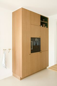 The Gaggenau oven and tall unit in solid oak. Everything is designed and produced by Nicolaj Bo at Teglholmen, Copenhagen.