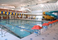 Somerset YMCA Pool by Carlton Pools, Inc.  Features 2 Water Slides, and Six Water Features by Carlton Pools, Inc.