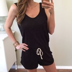"""Cozy Black Romper Purchased this cute black romper from another posher but it is just the slightest bit snug, so I've been debating on keeping. It is a super soft cozy fabric and has a """"dark denim"""" look to it. Perfect paired over a bikini or lounging around on a hot day. 55% cotton, 42% poly, 3% spandex. Elastic waist, faux drawstring detail. Price is firm, as this item is re-listed. Pants Jumpsuits & Rompers"""