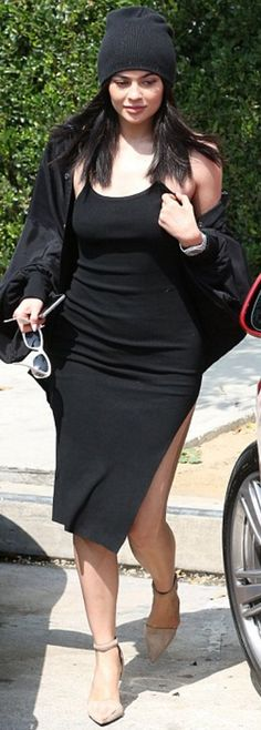 Who made  Kylie Jenner's white sunglasses and tan pumps?