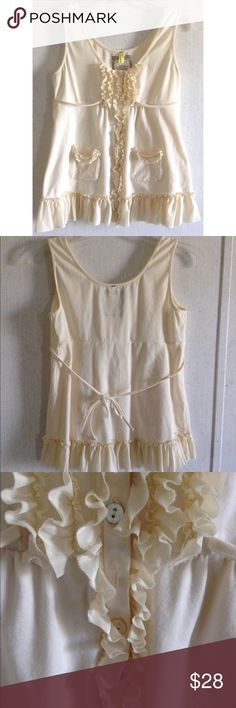 Pinkerton Silk Ruffle Tank Top Good condition. Little to no wash wear. Some pink marks on one of the ties. One missing button, kind of hides under the ruffle a bit. Super cute Pinkerton tank top from Anthropologie. Soft cotton and spandex blend fabric with 100% silk ruffle accents. Two small pockets on the front. Buttons up the front that look like shiny mother of pearl. Empire style cut with a tie in the back. Cream color. Size small. All offers welcome Anthropologie Tops Tank Tops