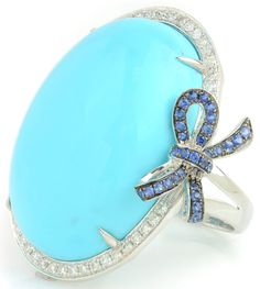 Calm down with this tranquil turquoise ring. 30.44 ct Turquoise Oval & 0.66 ctw Sapphire & Diamond Round 18K White Gold Ring Size 7