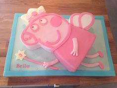 I made this Peppa Pig cake for my niece's 3rd birthday. Chocolate cake covered in lots of pink fondant; one very happy girl