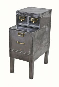 """refinished c. 1930's american depression-era pressed and folded steel factory office """"fireproof"""" filing cabinet with detachable four-legged base intact."""