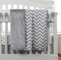 Mix and match patterns with this pretty gray color. Gray elephants rail cover, white and gray polka dot crib sheet, gigi crib skirt, and a gray chevron minky blanket all from Liz and Roo!