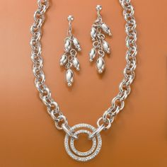 #Silver Linings Stylebook! Fun shiny sterling silver beads sway from chain links in these Italian Oval Bead Cluster Earrings. This Diamond Rolo-link Necklace is a strong, confident look styled with large-scale links and a double circle of .25ct. t.w. of diamonds. > Click on the pin to shop this look at Ross-Simons.