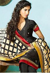 The most beautiful refinements for style and tradition. The dazzling black faux crepe churidar suit have amazing self print, zari and stone work. The entire ensemble makes an excellent wear. Matching churidar and light fawn and black dupatta is available with this suit. Slight Color variations are possible due to differing screen and photograph resolutions.