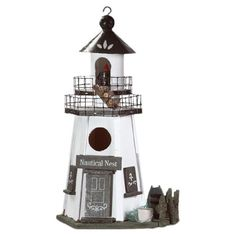 HOME DECOR – COASTAL STYLE – Bring a touch of nautical flair to your backyard or patio with this charming birdfeeder, showcasing a lighthouse-shaped silhouette and 2-tiered walkway.