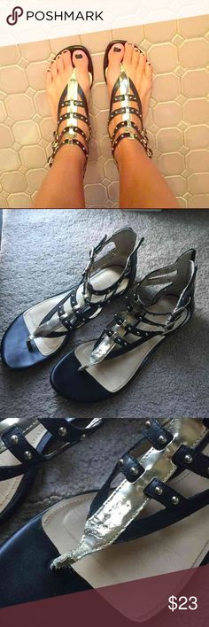Black and gold gladiator sandals Black and gold gladiator sandals. See pics for condition. Super cute and great for summer Enzo Angiolini Shoes Sandals