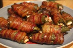 Atomic Buffalo Turds   Cut the top of jalapeños off and gut them .The seeds make them hot.   Stuff with cream cheese and then wrap them in bacon. Put a toothpick thru them to hold on the bacon. Grill them, bake them or fry on the stove    You could also chop some chicken (cooked) and mix with the cream cheese before stuffing