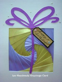 Lin Handmade Greetings Card: Purple and green parcel Iris Folding