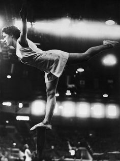 Cissie Davies of Great Britain on the balancing bar, during the Summer Olympic Games gymnastics event (transferred from the Wembley Stadium) at the Empress Hall, Earl's Court in London, United Kingdom on August 12, 1948. Eleven countries have entered the women's team competition. The competition is carried out on similar lines to the men's and comprises voluntary and compulsory exercises on swinging ring and beam, and springboard vaults over the pommel-horse. (AP Photo)