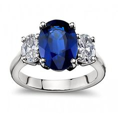 9.45 ct Oval Shape Sapphire With Oval Cut Diamond Anniversary Ring in 14 kt White Gold $6,499.00 (67% OFF)