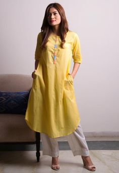 Order contact my whatsapp number 7874133176 Yellow White Kurta Pants SetFree Living brings you a collection of the sweetest shades of festive season. Simple classic looks paired well with silver jewellery and leather bag. Dress Neck Designs, Kurti Neck Designs, Kurta Designs Women, Kurti Designs Party Wear, Designs For Dresses, Salwar Designs, Simple Kurta Designs, Embroidery Designs, Embroidery Suits