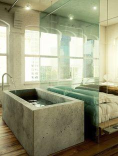 Gaaf badkamer/slaapkamer met een bad van beton!