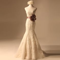 Strapless Trumpet/Mermaid Net wedding dress, without the bow, of course.