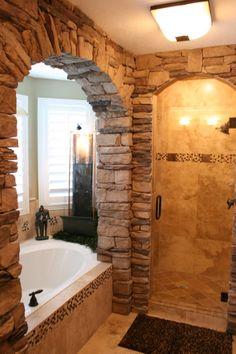 Stone work in the bathroom. Looks like a spa retreat.