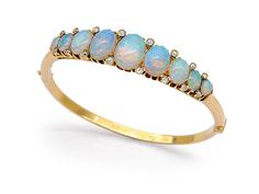 An Antique Opal and Diamond Bangle Bracelet, circa 1880  The oval hinged hoop set with a graduated row of oval opals, accented by small old mine-cut diamonds, mounted in 18k gold, inner circumference 6 ins