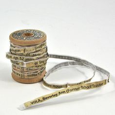 Nancy Yule - Spool Of Life, 2012, 5 H x 5 W x 5 D cm, Wooden Spool, Ribbon, Thread, Mothers Obituary