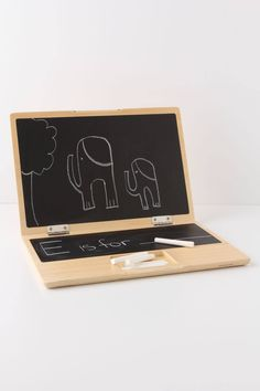 """Chalkboard Laptop - A low-tech toy for a high-tech world, this charming, solid wood chalkboard is suited for simple computations and graphic designs. 