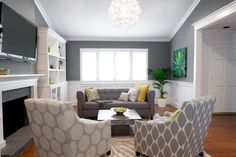 Tufted Chester sofa in grey linen - West Elm  Chair fabrics = Rosette and Ikat - West Elm  Pillows = West Elm, Pottery Barn, Crate & Barrel