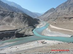 Confluence of Zanskar & Indus rivers, Leh, India.  Confluence - Known also as a conflux, it refers either to the point where a tributary joins a larger river, called the main stem, or where two streams meet to become the source of a river of a new name.