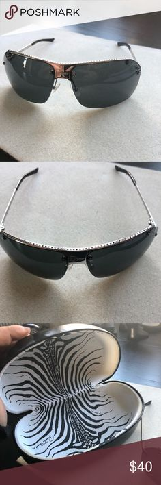 Dior sunglasses Nice shape, cute little star details. Some of the crystals along the top fell out but it looks good that way. A few minor scuffs on lens. Comes with a Cavali case. Christian Dior Accessories Sunglasses