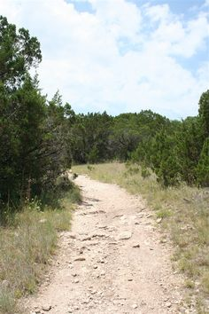Surprise sights--such as a masonry spillway and an elusive armadillo--await on this 5.5-mile loop that encircles Cleburne State Park's Cedar Lake.