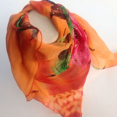 A personal favorite from my Etsy shop https://www.etsy.com/listing/249508914/vintage-silk-square-shawl-orange-big