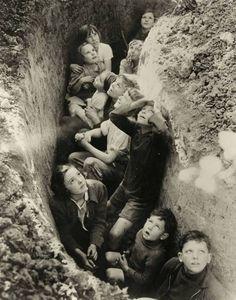 Children in a British bomb shelter, ca.1940–1941.