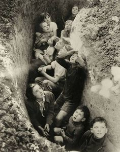 Children in a British bomb shelter, ca.1940–1941. S)