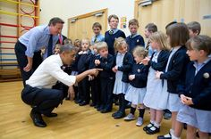 President Obama and British Prime Minister David Cameron visit with school children while in Enniskillen, Northern Ireland during the 2013 G-8 Summit.