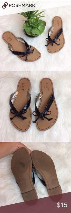 Loft Black Bow Flip Flops Loft Black glossy bow Sandals/flip flops. Size 7. Excellent condition. LOFT Shoes Sandals