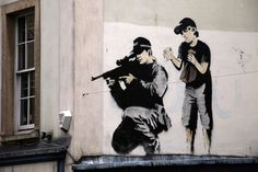 Police Sniper with Boy by Banksy