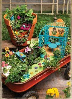 Fairy garden.    Love the wagon!