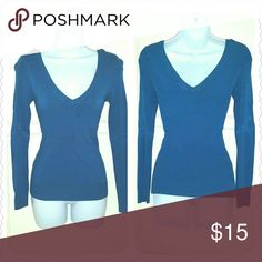 """Blue V-neck Sweater Shirt Blue, deep v-neck, long sleeve, ribbed sweater shirt. Some stretch & super soft! Curve hugging!    ? Max of 48 hr hold ? Bundling saves you money!!   ? NO SWAPS/TRADES ? Will ship next business day after purchase, EXCEPT on Sundays. ? Please ask any ???'s or for more pics.  ? Offers will only be considered when using """"Make Offer""""! Charlotte Russe Sweaters V-Necks"""