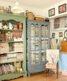 Craft room organization.  love the glass front cabinet to store material and other supplies for crafting inspiration