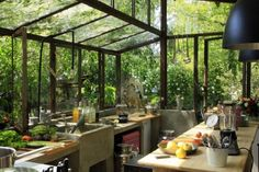 Kitchen atrium - Ok so when I saw this image I actually let out an audible gasp..  Dream kitchen indeed.