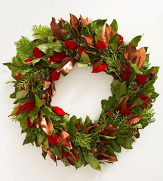 Leaves in shades of copper and red brighten a traditional wreath. More holiday wreaths: http://www.midwestliving.com/homes/seasonal-decorating/beautiful-holiday-wreaths/?page=27,0