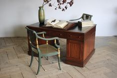 A 19th century English, Victorian partners desk, the rounded rectangular top inset with black leather writing surface, above an arrangement of nine drawers, with three opposing drawers and two cupboard doors, raised on plinth bases with casters. Antique Desk, Antique Furniture, Partners Desk, Mahogany Furniture, Cupboard Doors, 19th Century, Drawers, Black Leather, Surface