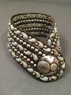 love that pear shape bead, this is from Jumping Mouse Beads store.