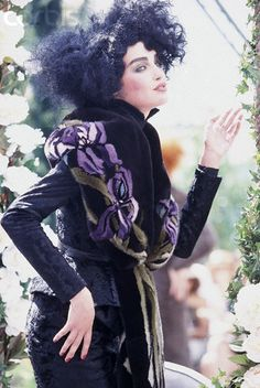 * John Galliano for Dior Belle Epoque inspired Fall/Winter 1997-1998 Model wearing a black moire jacket and skirt with floral printed fur shawl ca. 1997 © Guy Marineau
