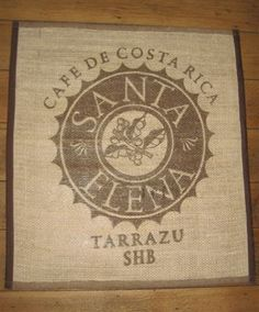 This is a reversible dual purpose piece - it's a rug or wall-art, from coffee sacks