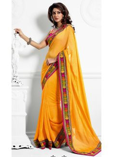 Rich Look Attire To Give Your A Right Choice For Any Party Or Function. Create A Smoldering Impact By This Yellow Faux Georgette & Jacquard Saree. Look Ravishing Clad In This Attire Which Is Enhanced Resham & Unique Border Work Work.