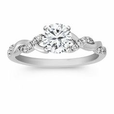 Wedding Rings Diamond and White Gold Infinity Engagement Ring with a Brilliant Round Diamond. Available with your choice of ruby, diamond or sapphire Engagement Solitaire, Vintage Engagement Rings, Solitaire Diamond, Diamond Rings, Solitaire Rings, Infinity Engagement Rings, Sapphire Rings, Twist Engagement Rings, Band Rings