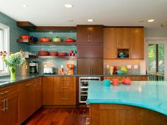View the energetic turquoise concrete countertops and tile backsplash in this mid-century modern kitchen on HGTV.com.